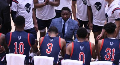 Howard University men's basketball head coach Kenneth Blakeney during a timeout (center)